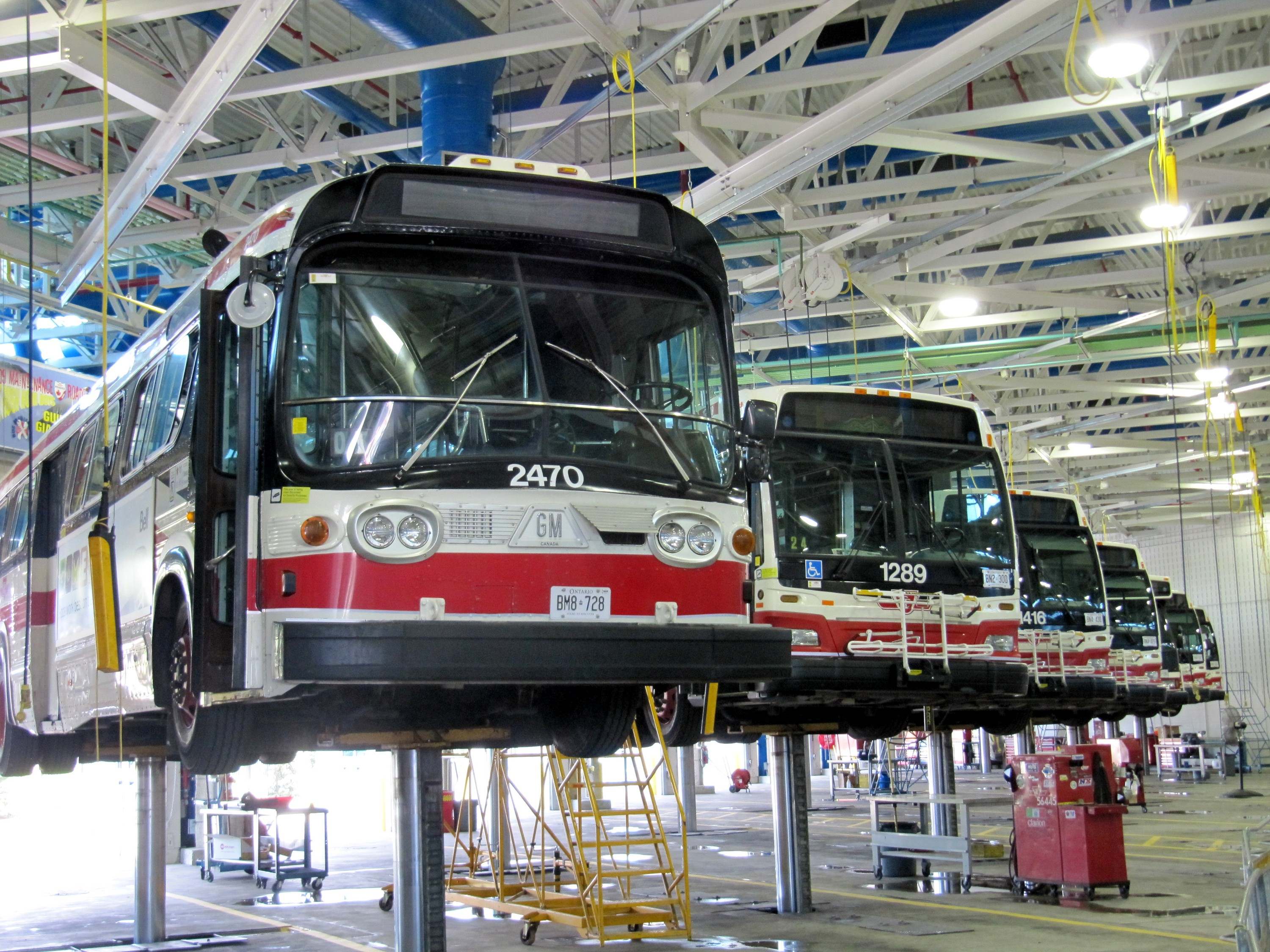 Buses on lifts in maintenance garage