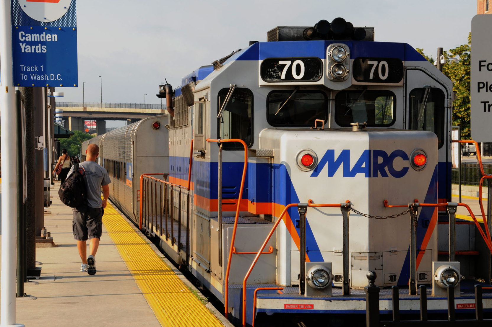 Passenger walks along MARC train platform