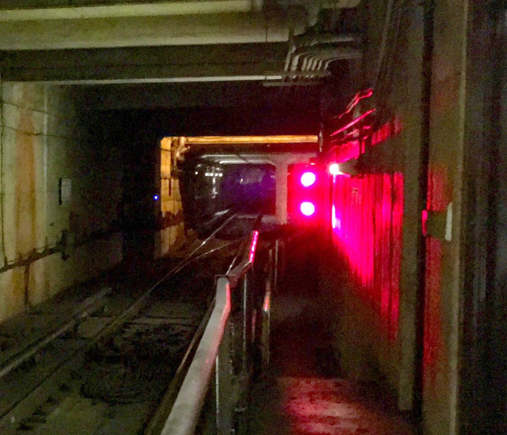 Red stop signal in subway tunnel