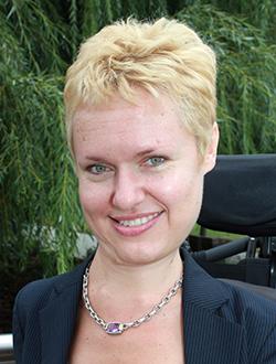 Headshot of Selene Dalton Kumins - Associate Administrator for Civil Rights