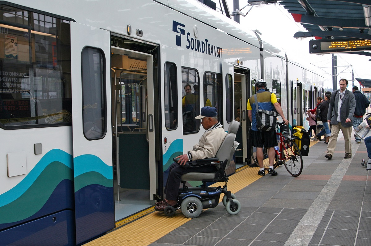 Passengers board Sound Transit light rail