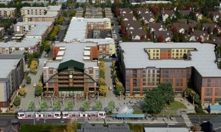 Aerial image of light rail train surrounded by development