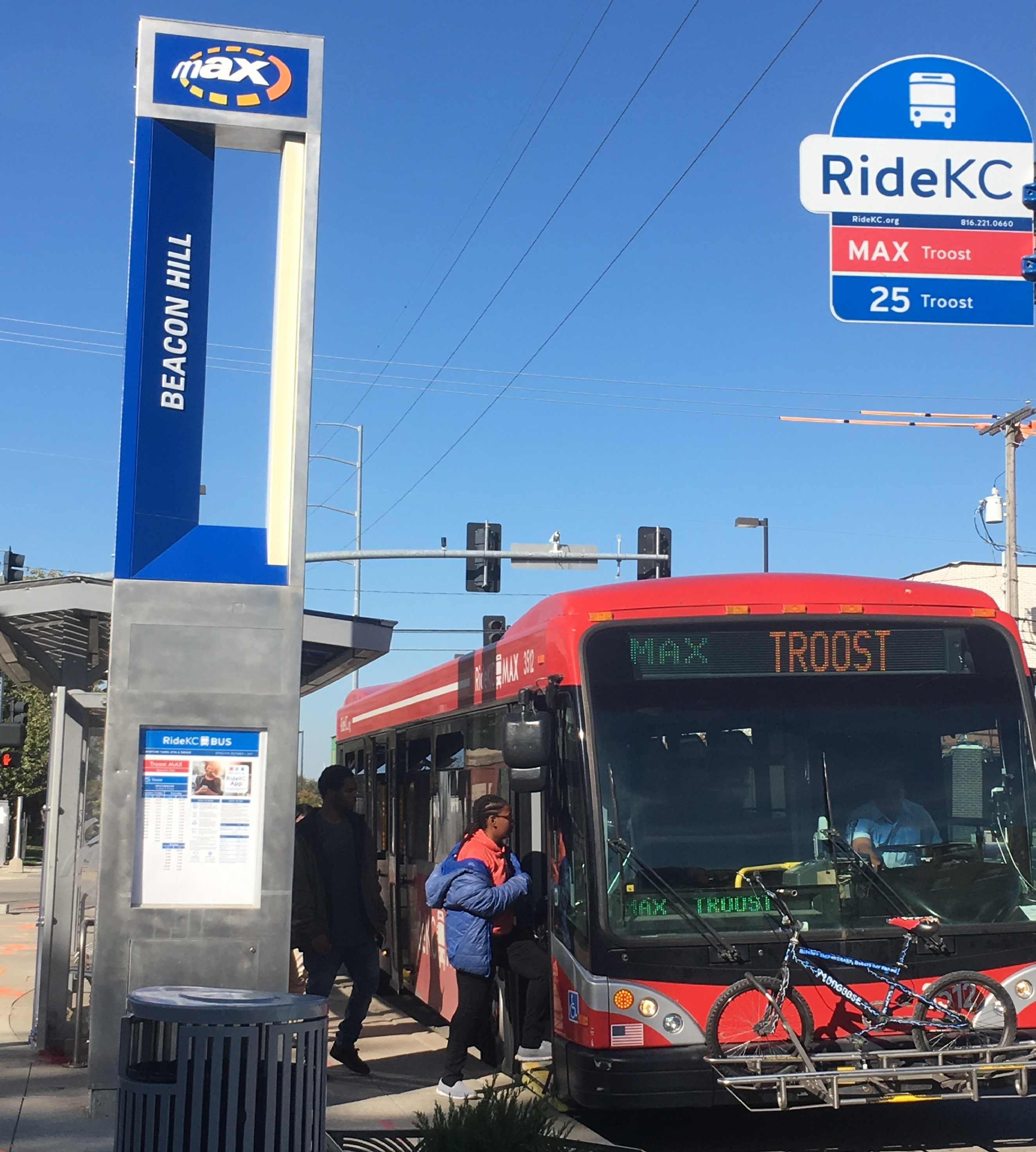Passenger boards a Troost MAX bus in Kansas City