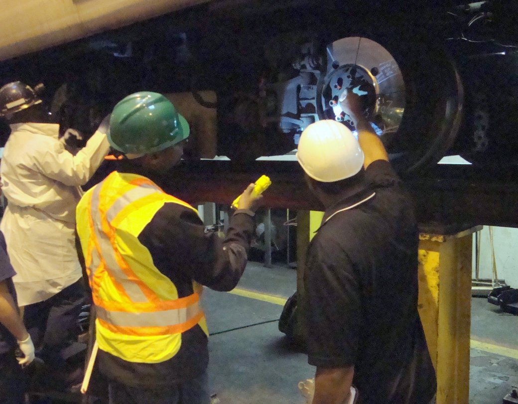 FTA contractors inspect subway car