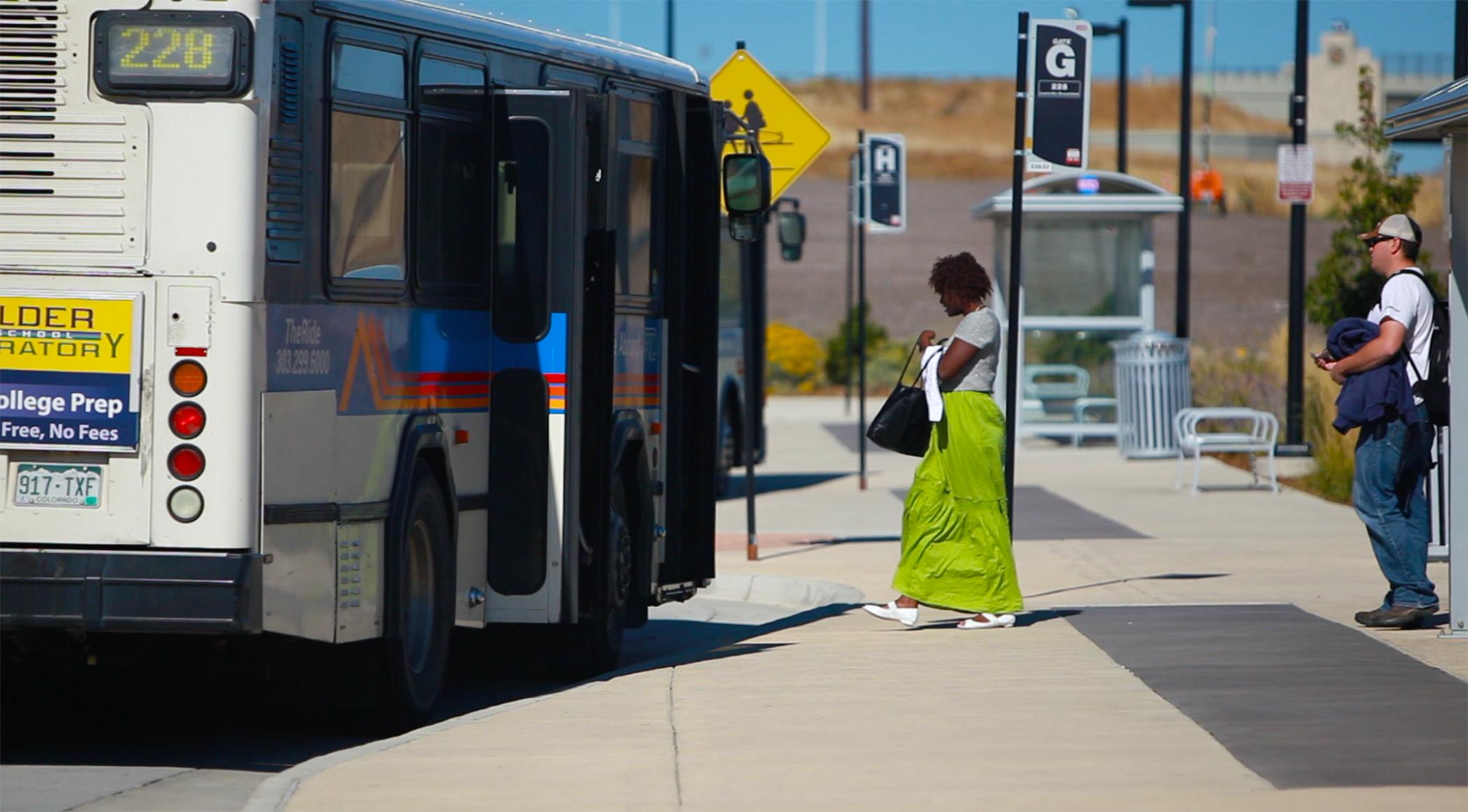 Passengers board bus