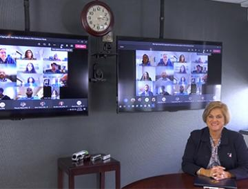 two TVs with video conferencing view on