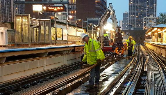 Safety workers working o n a subway line